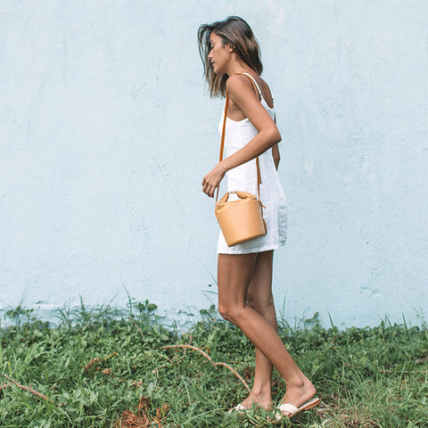 Kimi Juan of Escape Journal with Dive Bucket Bag in Taffy