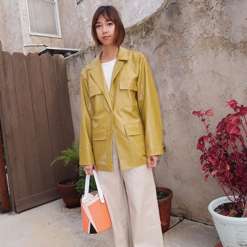 esemble seen on Stephanie Arant SS19 Serra Bucket Bag Tangerine-Chai_17022019