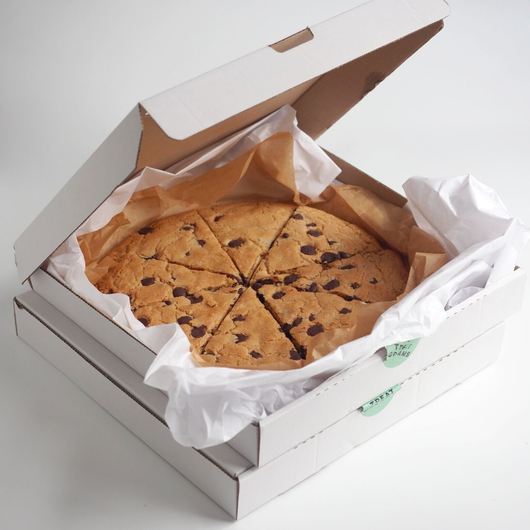 Pizza box with giant chocolate chip cookie