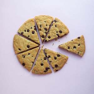 Giant chocolate chip cookie vegan cut into pizza slices