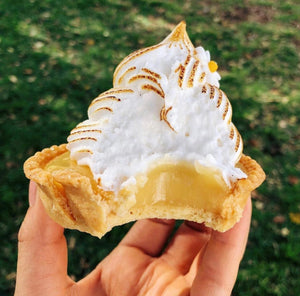 Sydney vegan lemon meringue tart. Zesty, gooey lemon curd topped with toasted vegan Italian meringue in a vanilla vegan pastry shell.