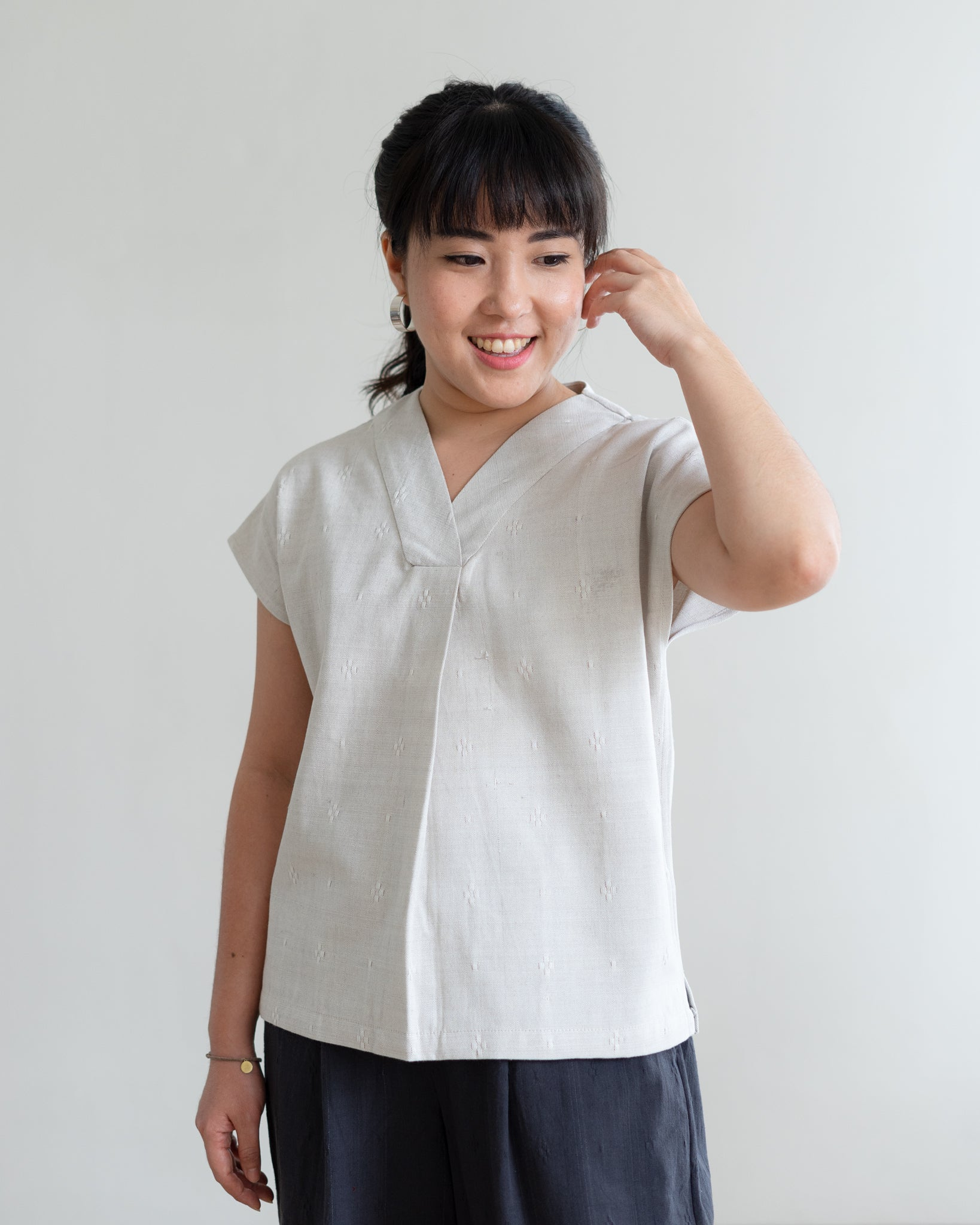 TITIK - Pleated V-Neck Top