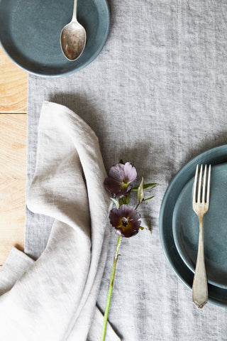 Linen napkin and grey stoneware plates