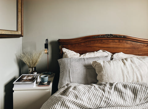 A bed with sustainable striped bed linen made in the UK | Aerende