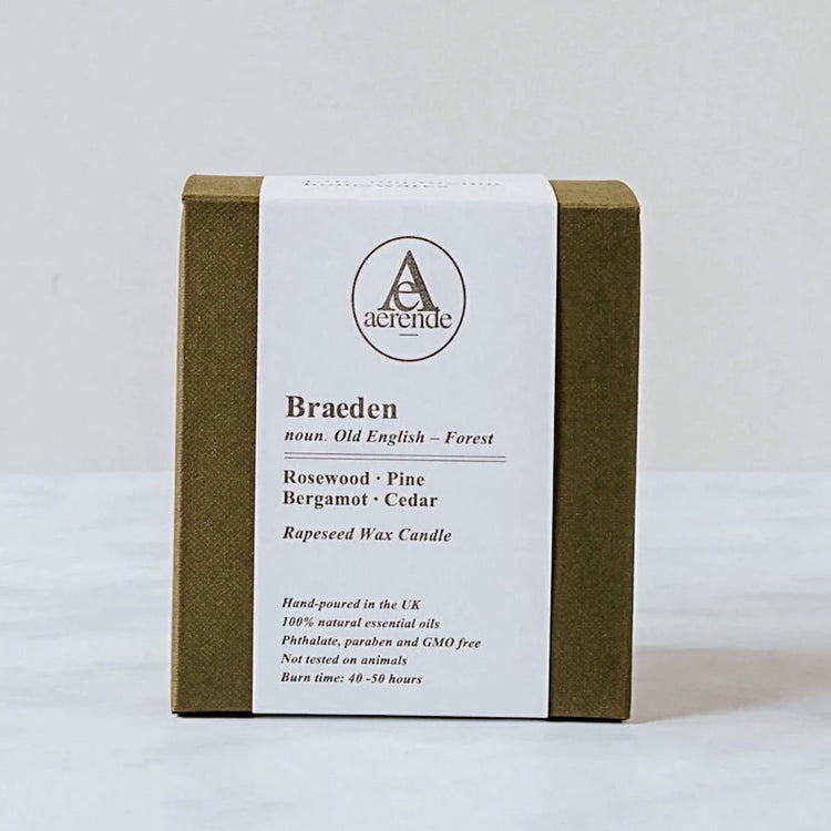 An olive green textured candle box with a letterpressed bellyband