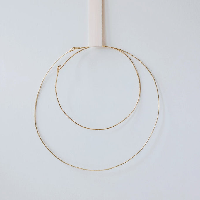 Two hand-hammered brass hoop rings