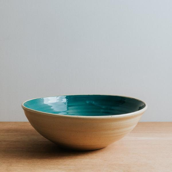 Natural stoneware serving bowl with teal interior