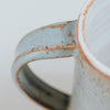 close up of blue mug handle