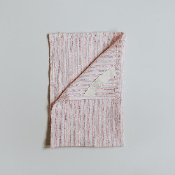 Pink stripe linen tea towel, handmade by refugees in the UK