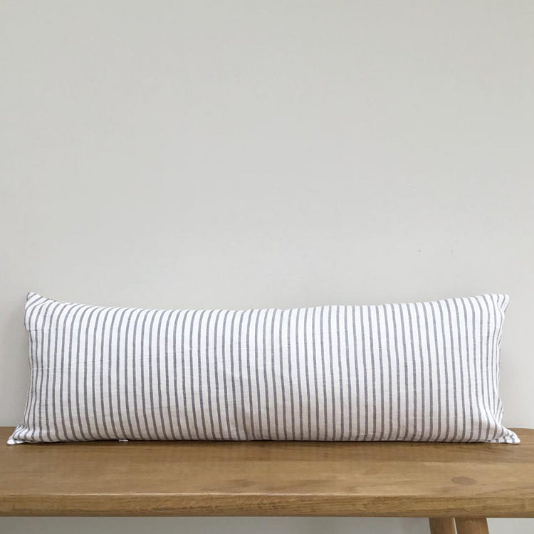 Large Striped Linen Lumbar Cushion On A Wooden Bench