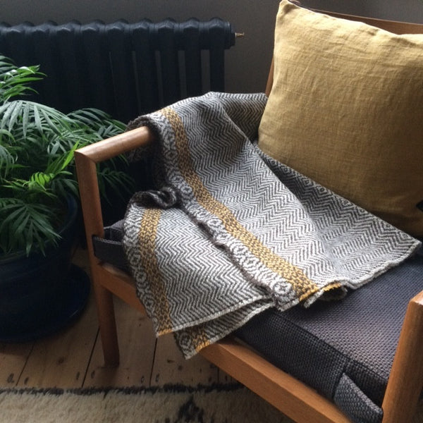 Handwoven wool blanket and linen cushion