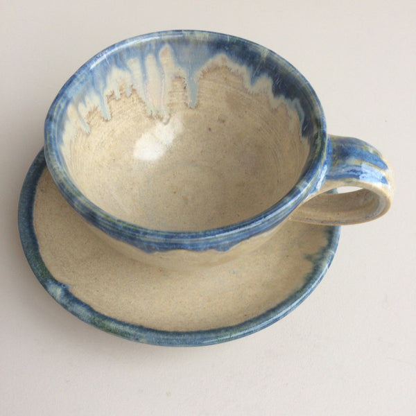 stoneware coffee cup and saucer
