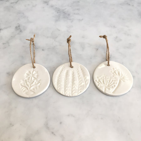 Three hand patterned porcelain Christmas decorations