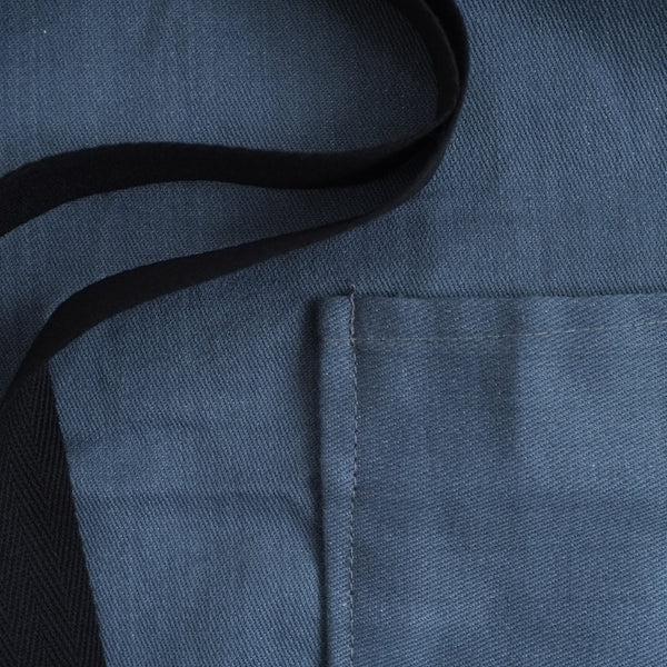 denim apron pocket closeup