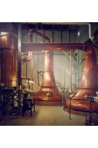 Pot stills at the Loch Lomond Dstillery. Note the different heights and shapes of the necks