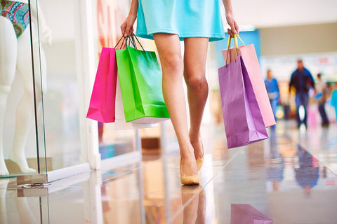 StyleAura - freepik.com - Close-up of a Woman holding Shopping Bags