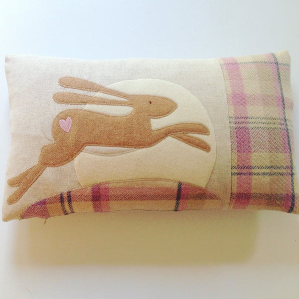 Pale pink leaping hare