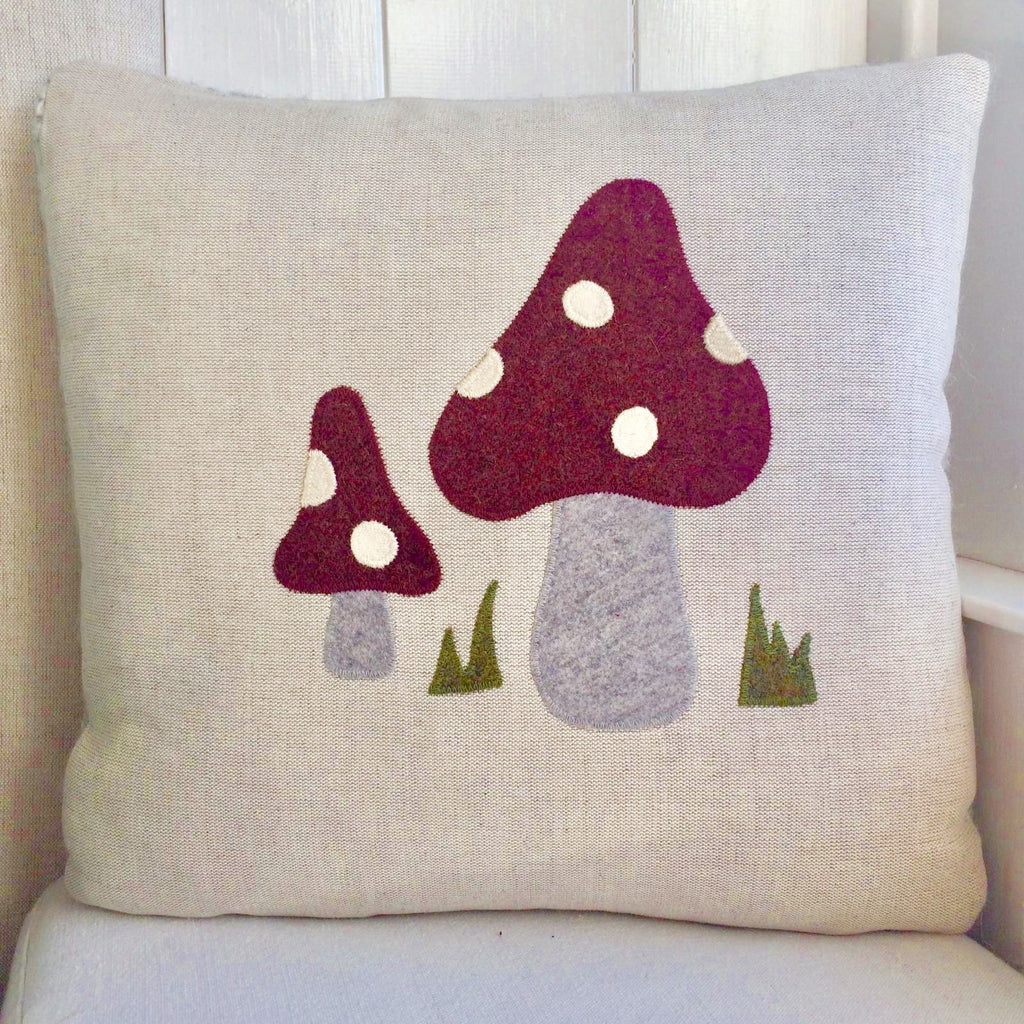 Handmade toadstool cushion in vintage red wool