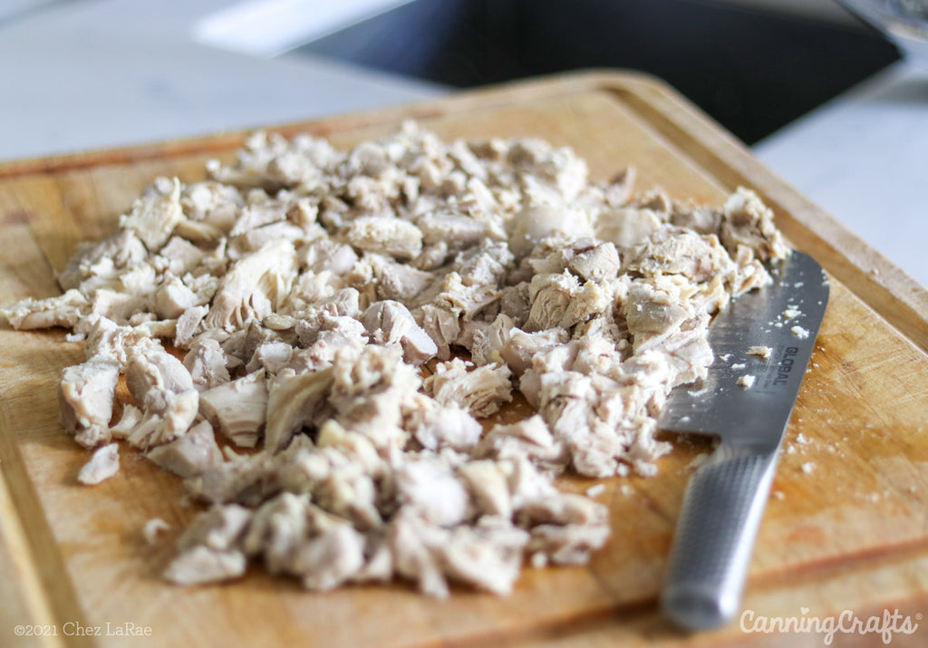 Cut up Cooked Chicken for Chicken Soup Pressure Canning Recipe | CanningCrafts.com
