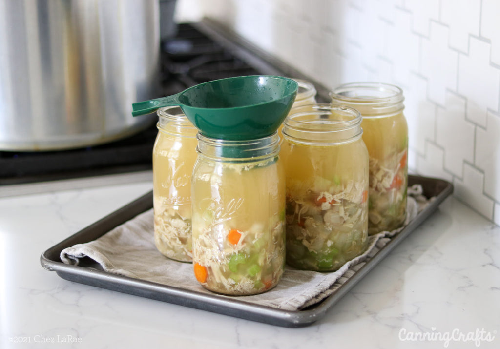 Filling Quart Jars for Chicken Soup Pressure Canning Recipe | CanningCrafts.com