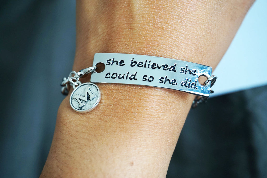 """she believed she could so she did"" with name initial Bracelet with Silver chain"