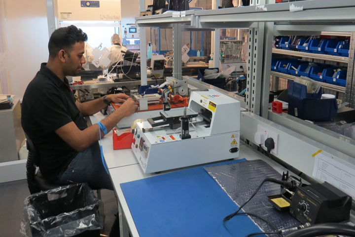 iSmash chiswick employee repairing a phone on a workbench