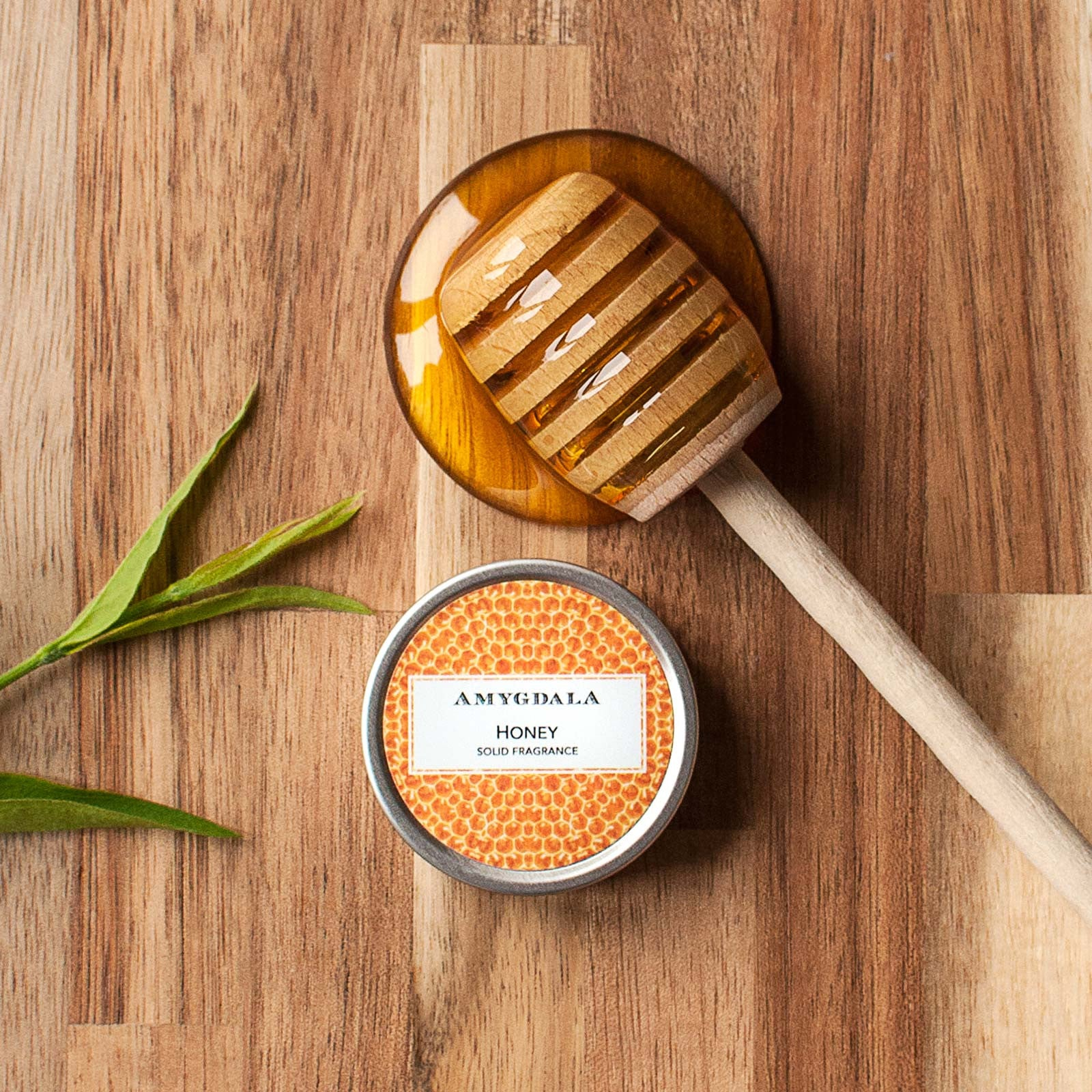 honey solid perfume with honey spoon