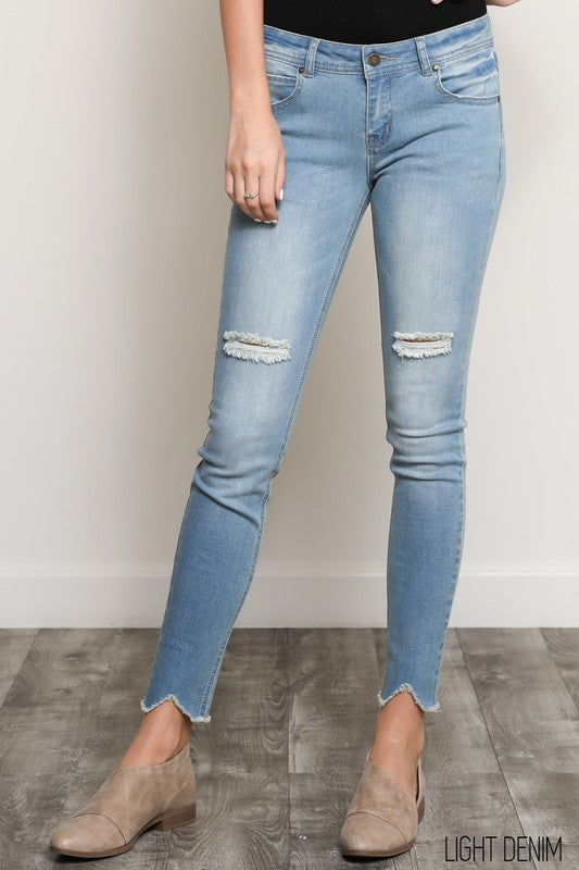 Faded 5 pocket style torn crop skinny blue jeans with frayed hems in NEW medium denim color!