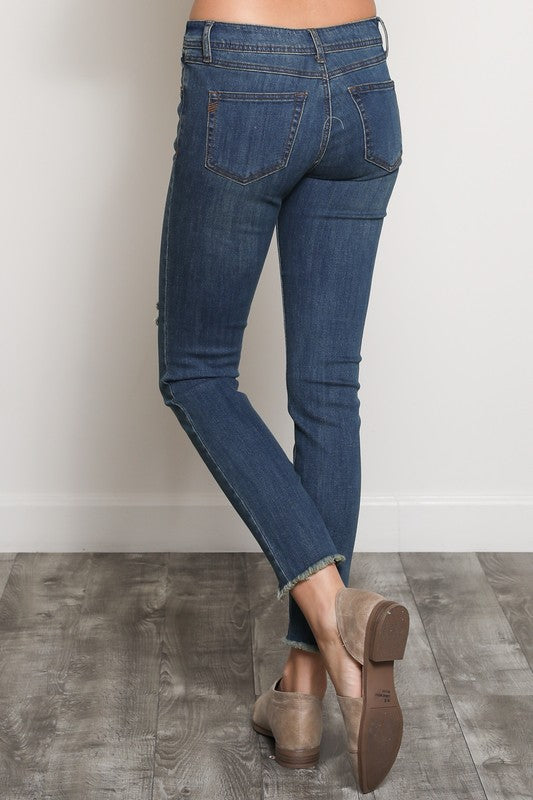 The Samantha Skinny crop jeans with destressing and raw edge hems