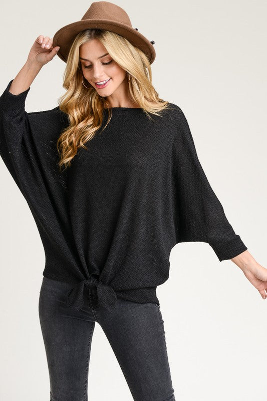 KNIT DOLMAN TOP WITH A BOAT NECKLINE AND SELF TIE HEM MADE IN USA 95% POLYESTER 5% SPANDEX