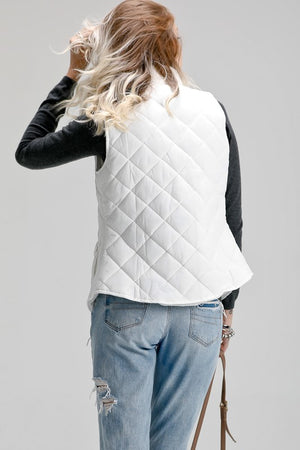 Solid cozy padded vest with pockets and zip up front in white