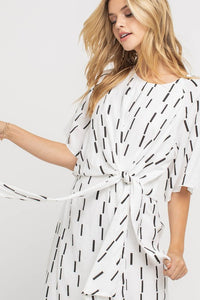 Sophistaticated wide sleeve midi dress with a rounded neckline