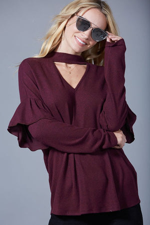 The Gwen burgandy top with slight ruffle sleeve and v-neck with cutout front