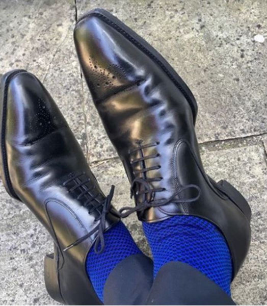 dark blue suit black shoes