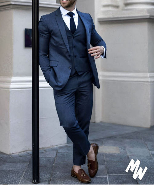 navy suit with brown shoes