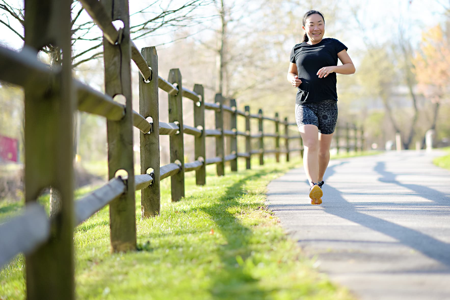 woman running in longer blyss running shorts