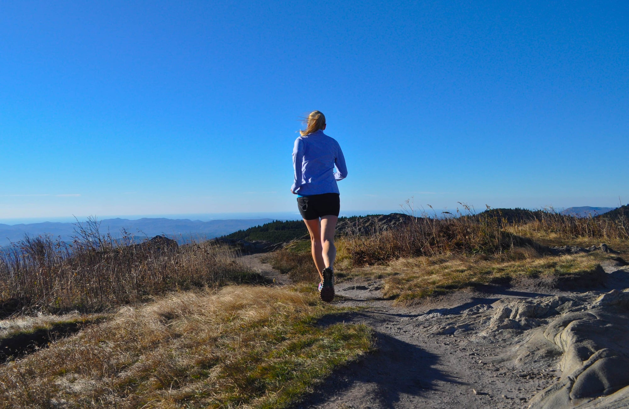 woman leaning on post in trail running skirt