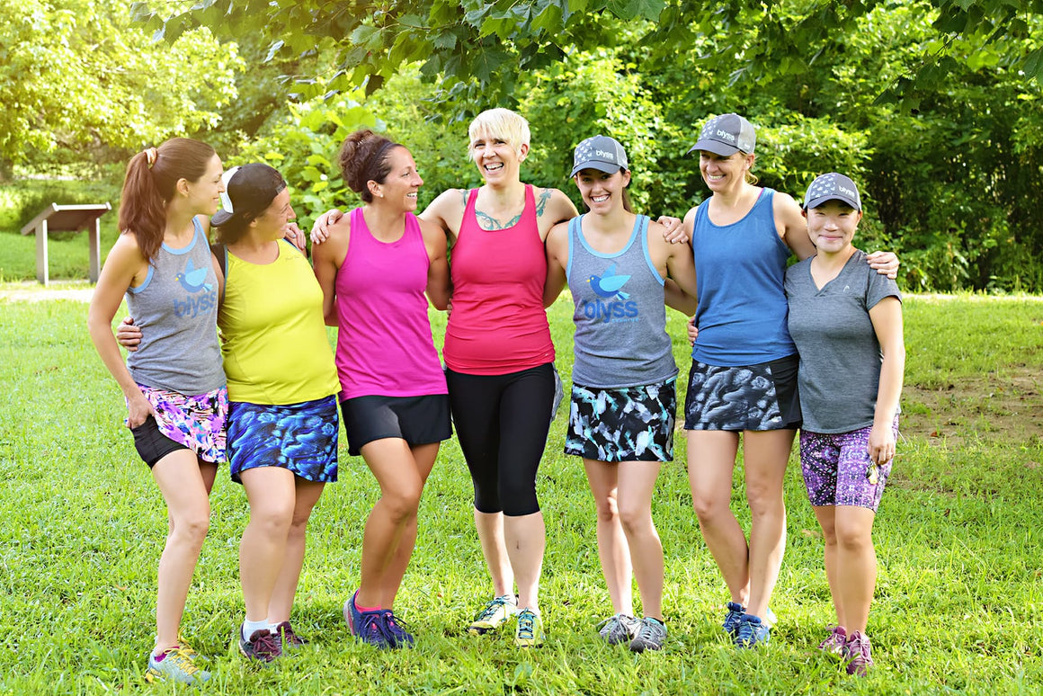 women standing in park in blyss running clothes