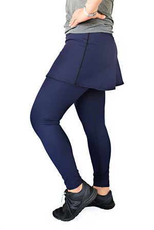 Navy skirted tight side view with leg bent