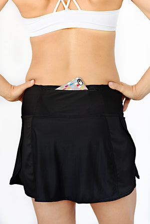 trail skirt in black with phone zipper pocket