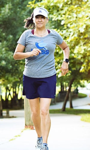 woman running in her navy skirt
