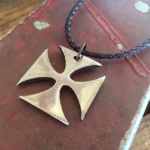iron cross necklace crafted by metal artist Jon WATTO Watson