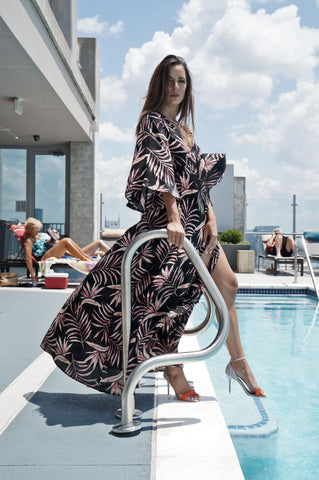 Posh girl Selina Pleuss models Amuse Society dress and Dolce Vita heels at the Nashville Skyhouse rooftop pool