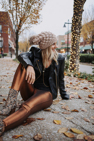 Free People Shine Girl legging in copper paired with Free People black leather jacket and Sam Edelman booties.