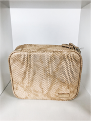 Stephanie Johnson travel bag in gold snakeskin