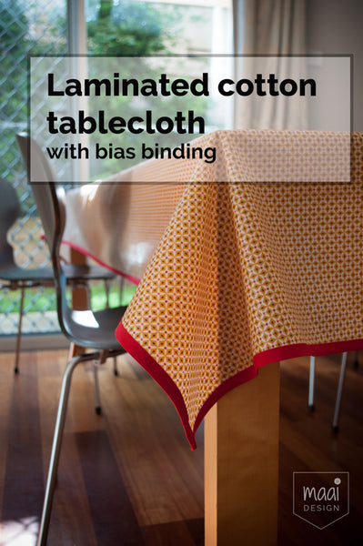 Laminated cotton tablecloth with bias binding