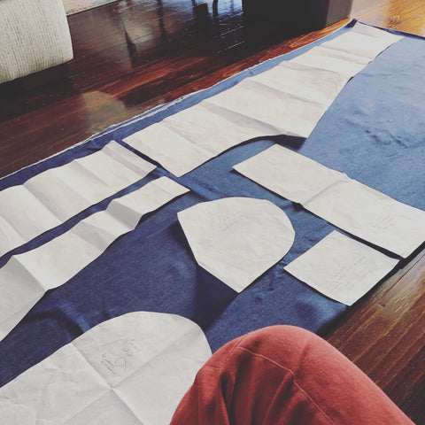Laying out the pattern of the Palisade Pants on the floor for cutting