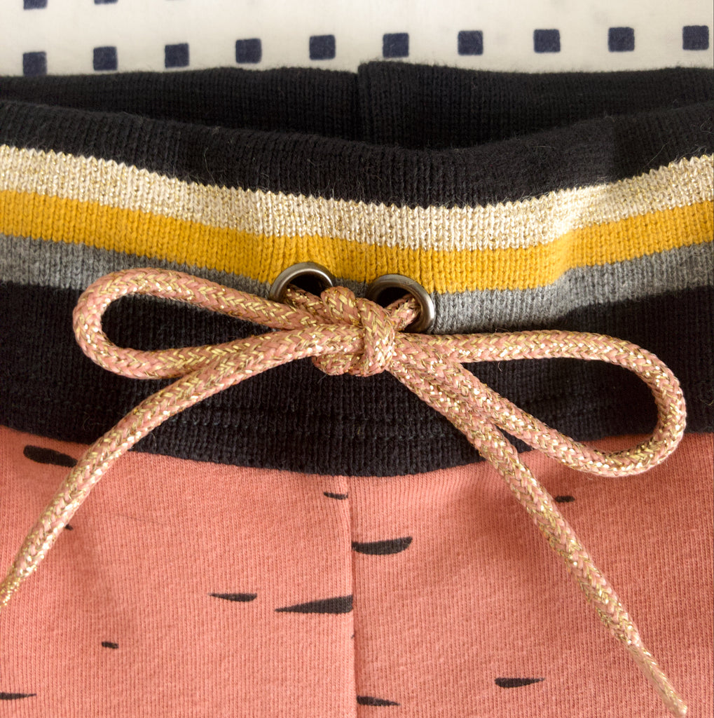 close up of folded cuff and shoelace waistband