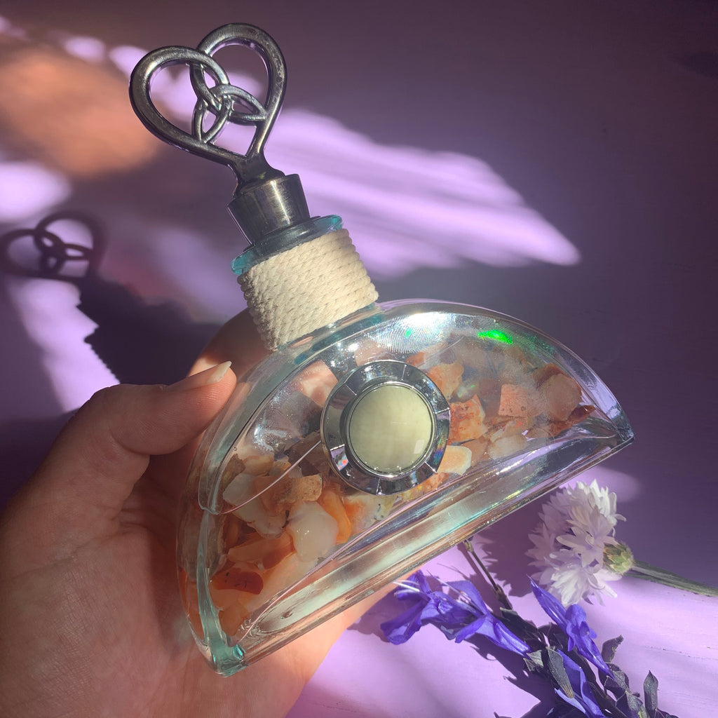 Opal filled vintage Triquetra heart bottle