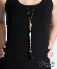 Gold and turquoise beads and tassel pendant